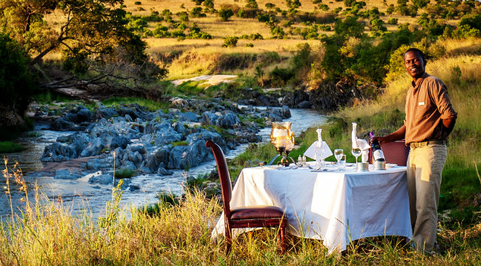 sand-river-masai-mara-dinner-set-up-with-view-4
