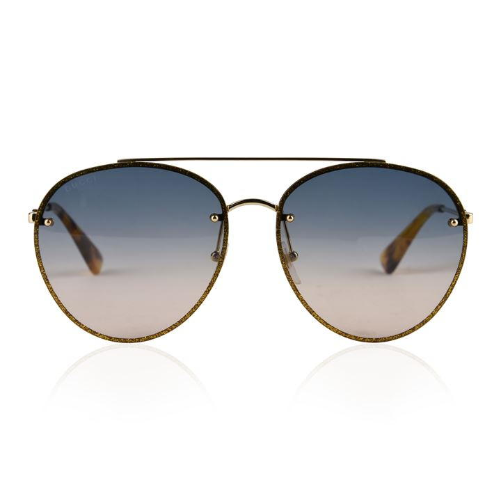 358250924f These sunglasses are great for that everyday. Crafted in Italy, this pair  is designed with a wide round shape injected with glitter on the outer  border of ...